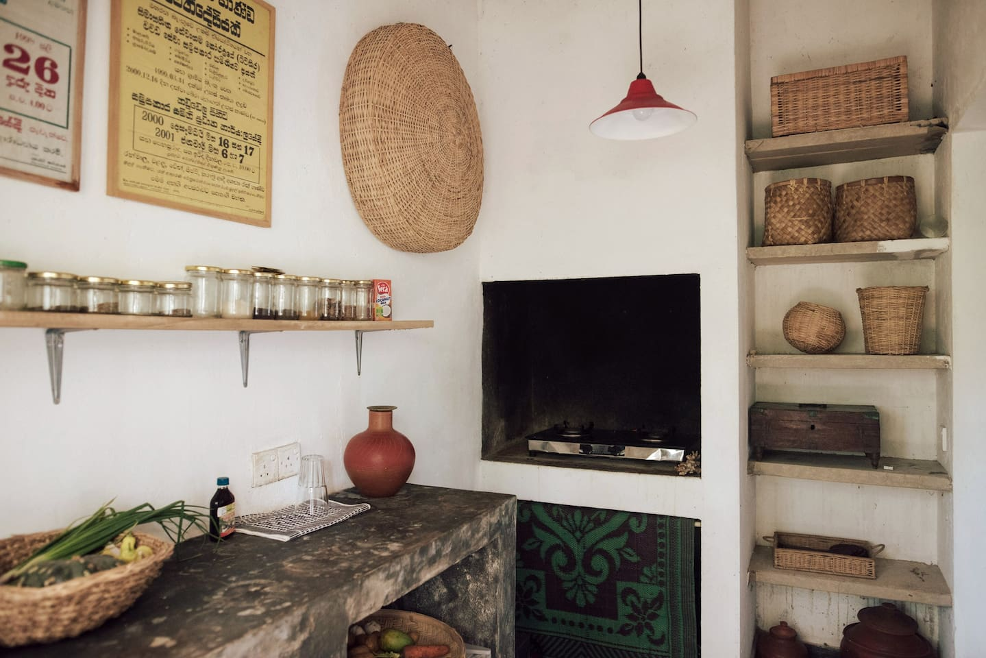 Indoor section of our indoor-outdoor kitchen.   The kitchen has a stove, electric kettle, mini fridge and cooking utensils all available to you.   *Veggies can be ordered.