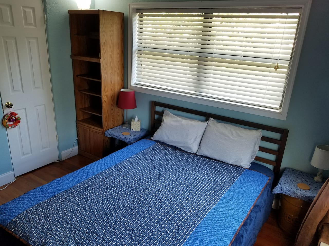 Comfortable queen size bed with extra pillows and blankets available, stored in the closet in the room for your convenience.