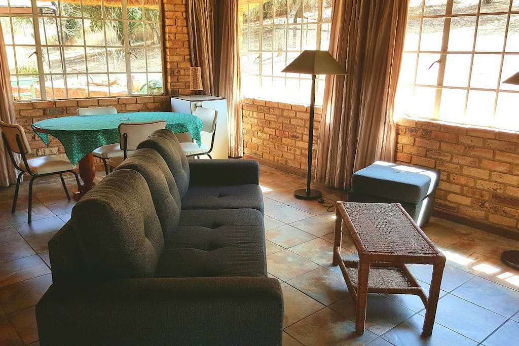 Two units rented out together - living area with DSTV