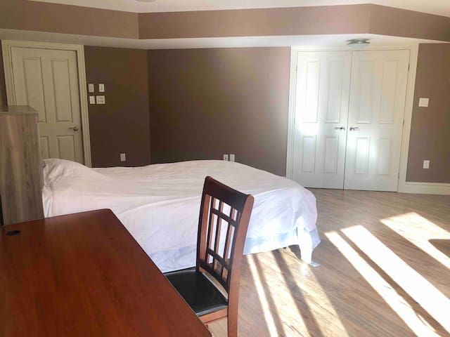 Spacious room with separate entrance from backyard