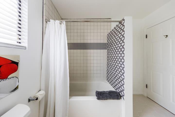 new soaking tub, designer tiles  and shower