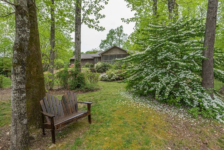 Spacious green space and pathway to creek and fire pit