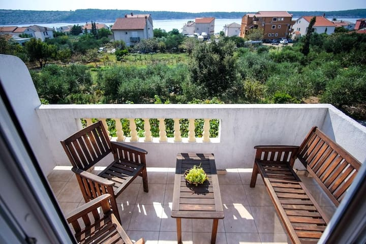 One bedroom apartment with balcony and sea view Barbat, Rab (A-14431-c)