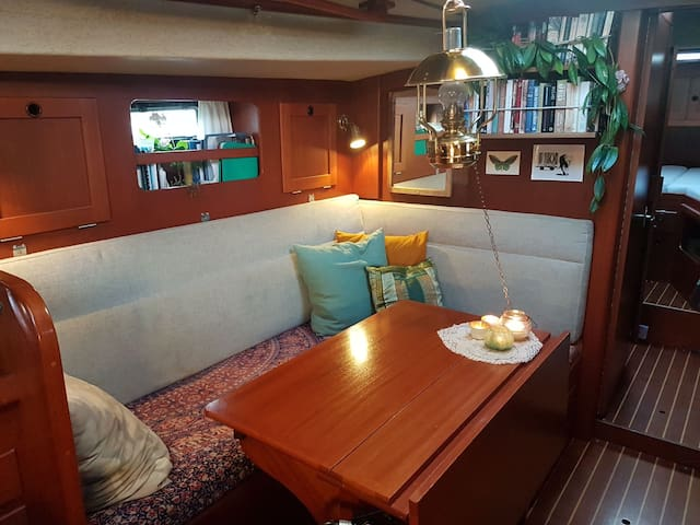 Welcome aboard!  Step down to the cosy living room. The seating area can easily take 6 people. In the evenings you can lit candles and the warming oil lamp, play games and listen to the wind outside. The two sofas can be used as beds.