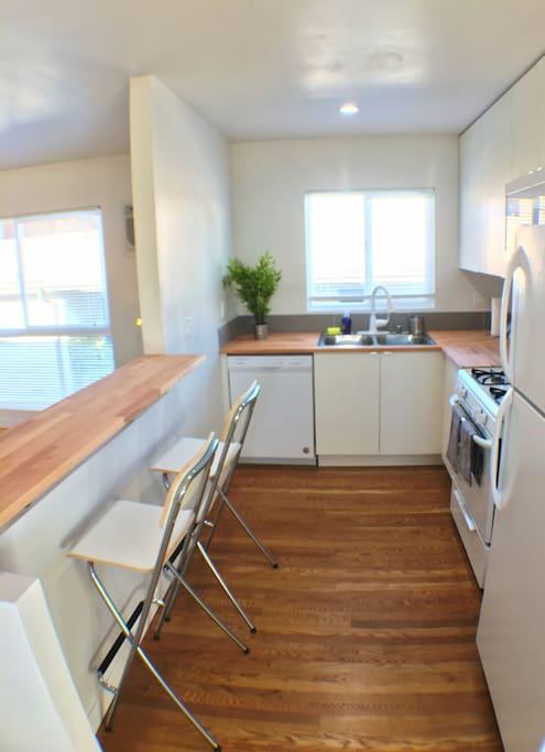 New Kitchen with with Butcher block countertop and Breakfast Bar