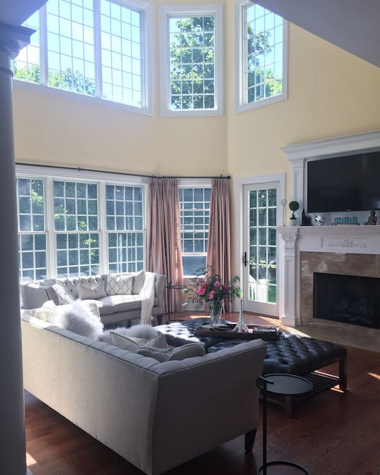 Huge 2 story Family room with brilliant morning sunlight, perfect place for coffee