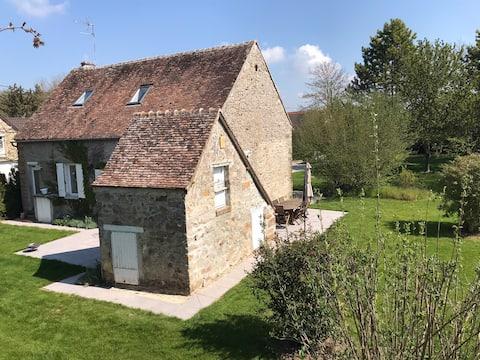 Maison de campagne et jardin arboré en Champagne