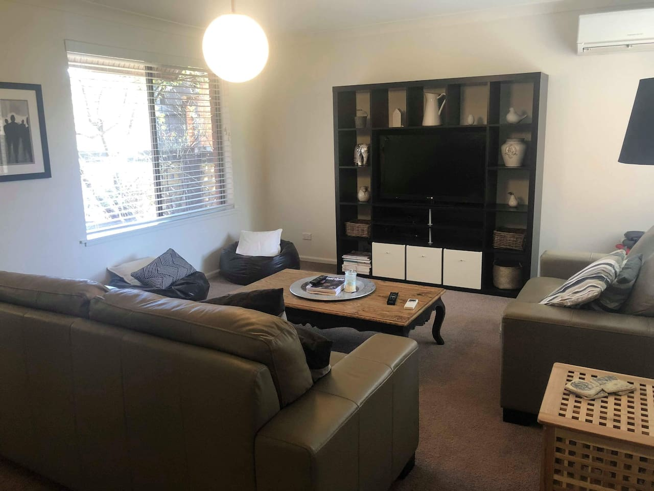 Large lounge room for the family, comfy leather lounges playstation for the kids