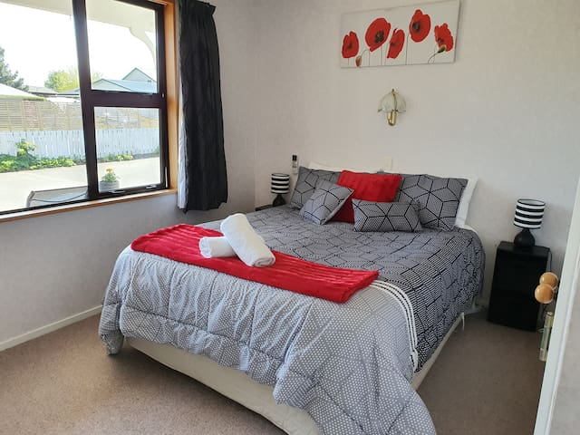 Main  Queen bedroom, has 2 luggage racks that are not visible, very roomy does have wardrobes for hanging clothes