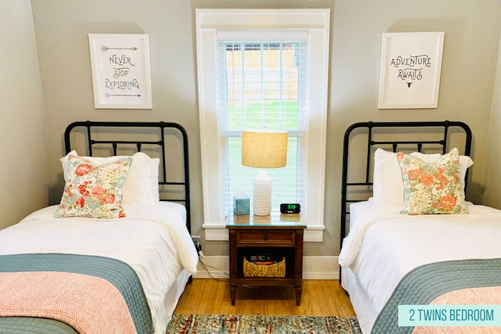 The twin bedroom offers two extra-long twin beds, luxurious sheets, a comforter with duvet and/or coverlet. The room also has a ceiling fan, desk fan, plenty of electrical outlets, a bedside USB charging station, desk, and mirrors.