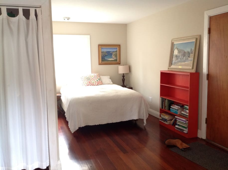 Sealy Posturepedic queen bed on the other side of bedroom