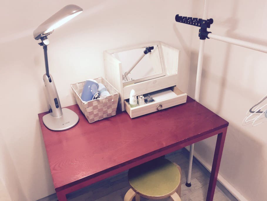 Desk lamp, hair drier and dressing table with mirror on a cute red table!