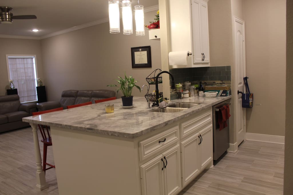 Kitchen with granite countertop and bar stools