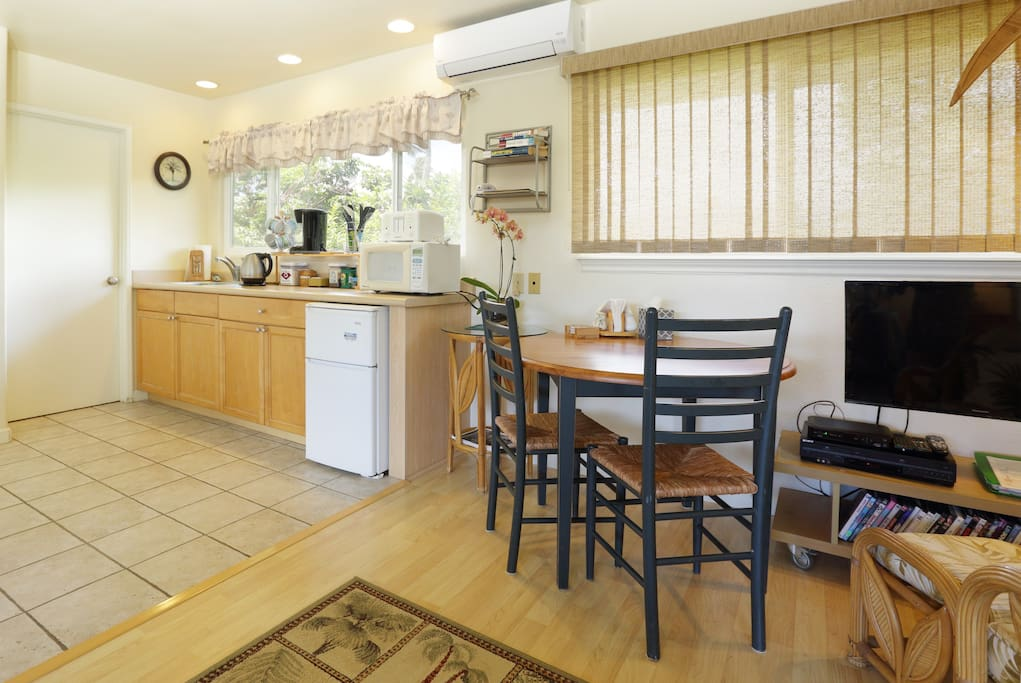 The kitchenette features lots of counter top appliances.