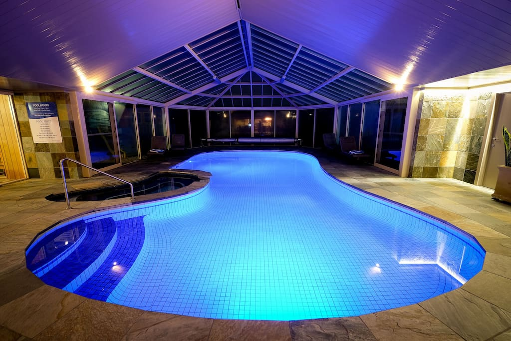 Indoor heated pool/spa at night