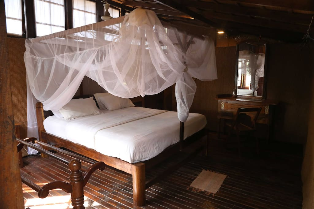 Hut inside with king size bed, comfortable metres and mosquito net