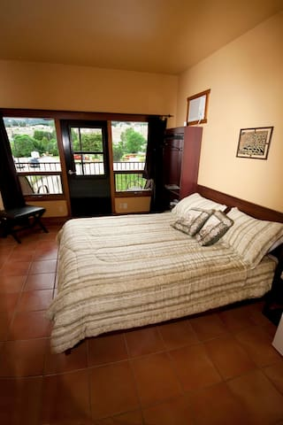 The Hideaway room is the smallest room. With a private entrance and private patio. Has a standup shower, no tub.