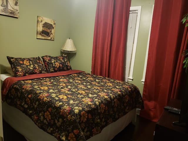 Private room with queen bed and fresh linens.