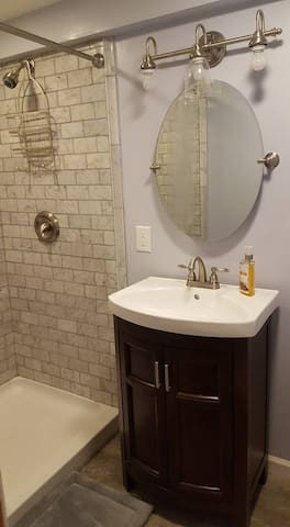 Full bathroom with subway tiled shower