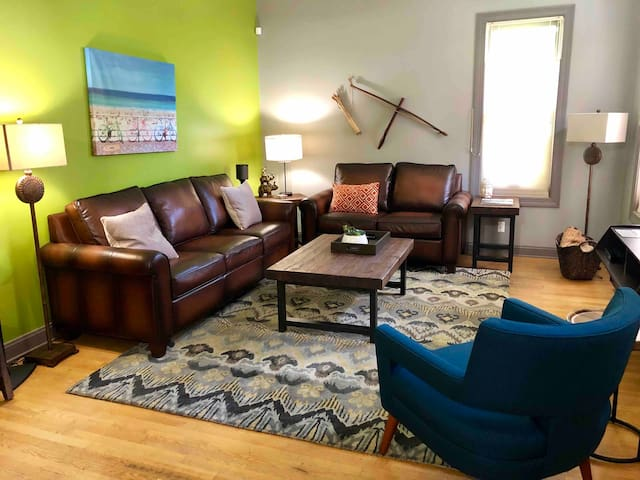 Large spacious Living Room with flat-screen Smart TV:  easy login to your Netflix, Amazon, or Hulu accounts!  TV also features an antenna for local channels, roaring surround sound, and a DVD player with some classic movies available.