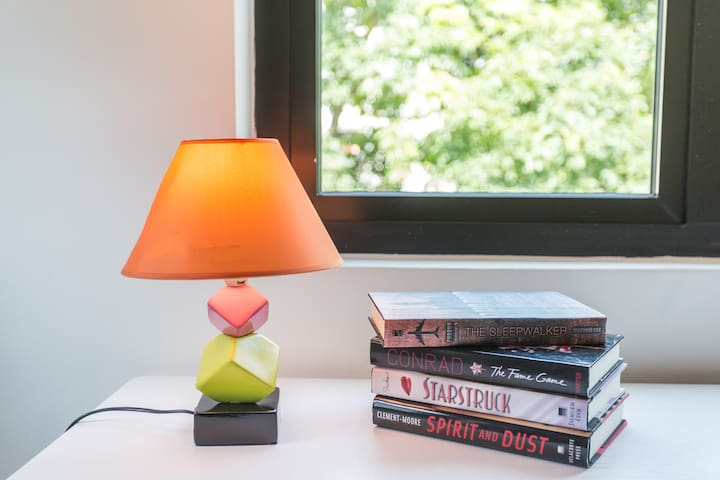 Similar side table lamps are provided in rooms