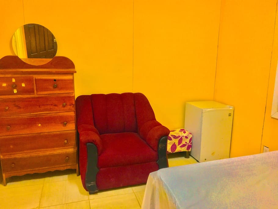 Your personal fridge couch with foot stool and dresser.