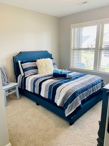 Guest bedroom 1 with full size bed that sleeps two. Super comfy.