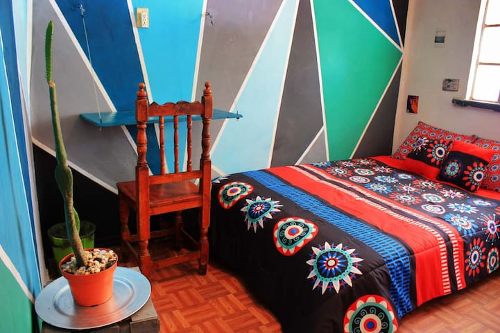 Your room in authentic old Mexican neighborhood.