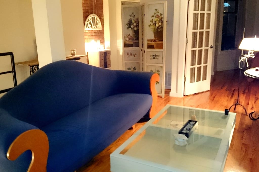 """The living room with IDEE Japan designer sofa """"Blue Wave""""."""