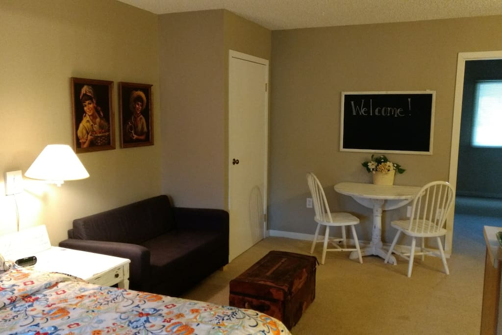 Room 1- King bed with small pullout love-seat, kitchenette and dining area