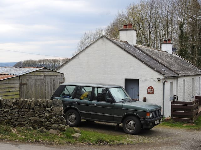 Here's how to spot the Cottage. The View of the Cottage with a view of the South Galloway hills in the background.  with an Old Green Range Rover parked out the front.  DIRECTIONS: https://www.youtube.com/watch?v=HOBLuqEJE_M&t=16s