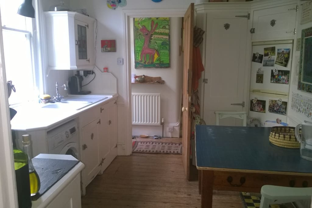 This is my kitchen with a table for four. There is a door out to the garden in the corridor