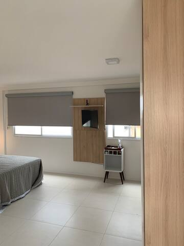master bed - huge and open with en-suite bathroom and access to terrace. 32 inch samsung smart tv with cable and netflix