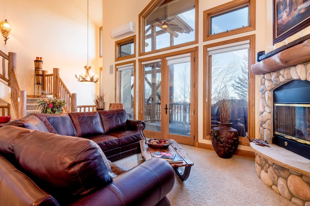 Tall windows and vaulted ceilings add a wonderful sense of space and light.
