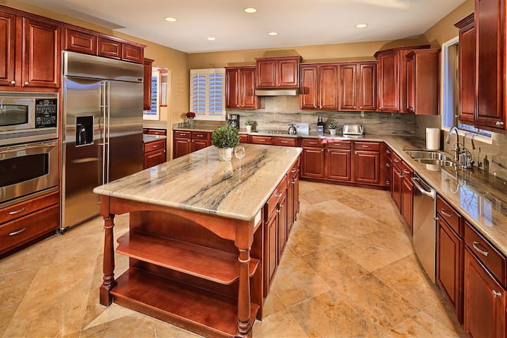Stunning kitchen with solid wood cabinets and granite counters