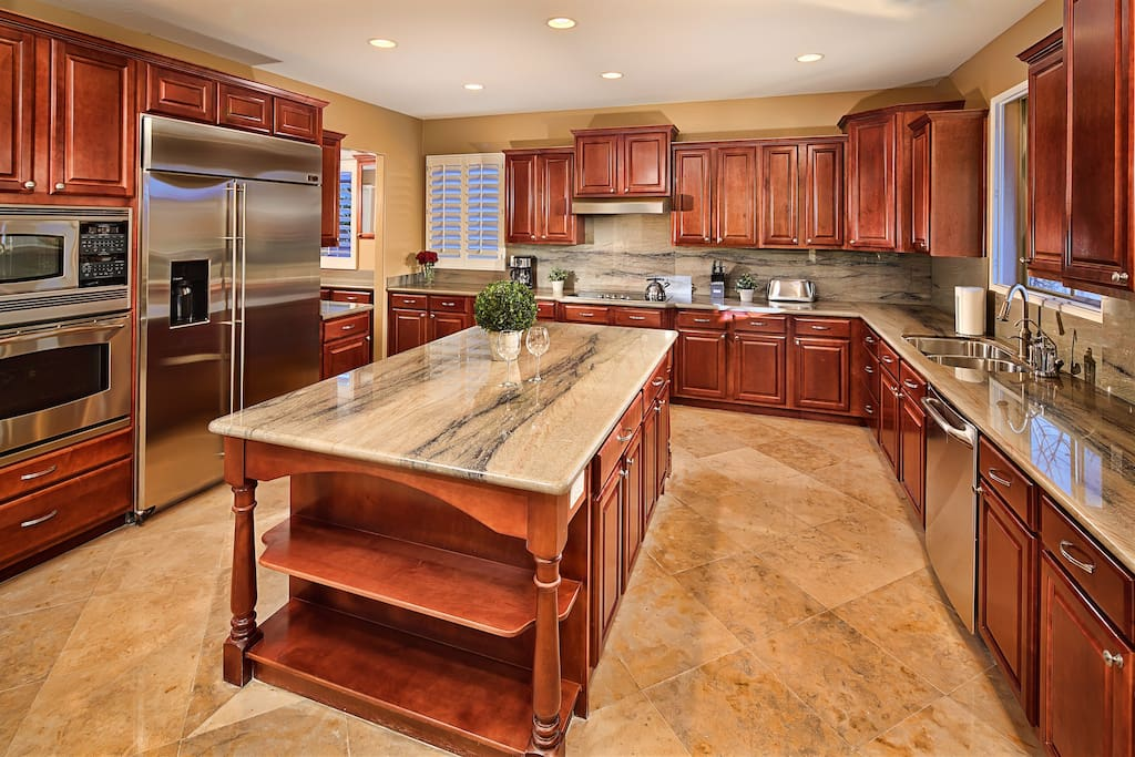 Stunning kitchen with solid wood cabinets and granite counters.