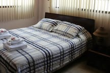 Bedroom: 1 Queen bed and 1 single sofa bed