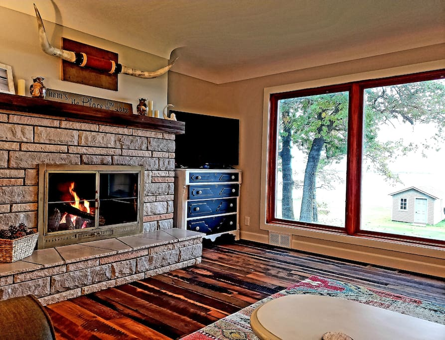 Living room with gas fireplace,  smart TV, awesome view of lake