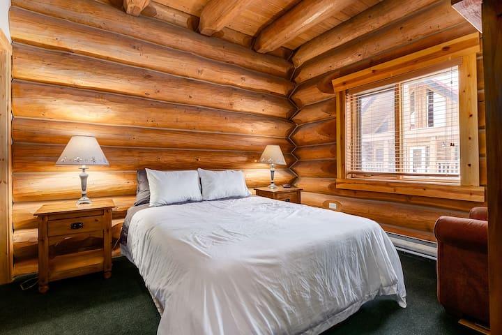 Beautiful bedroom in log cabin