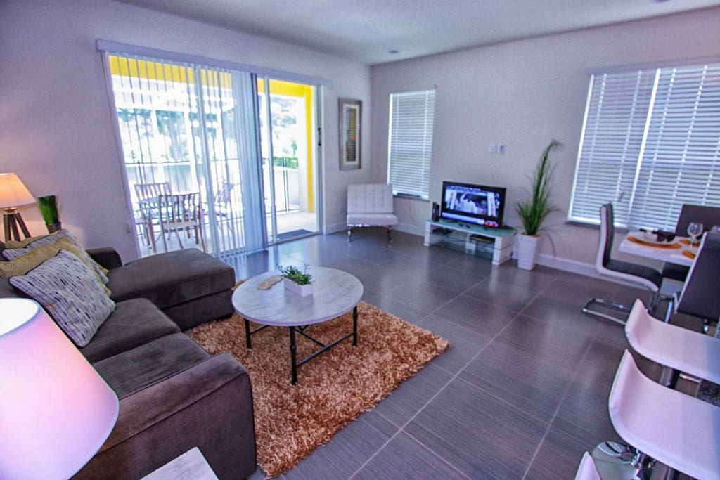 Living Area w/Upgraded Furniture, Tiled Flooring, Flat Screen TV & Pool Access