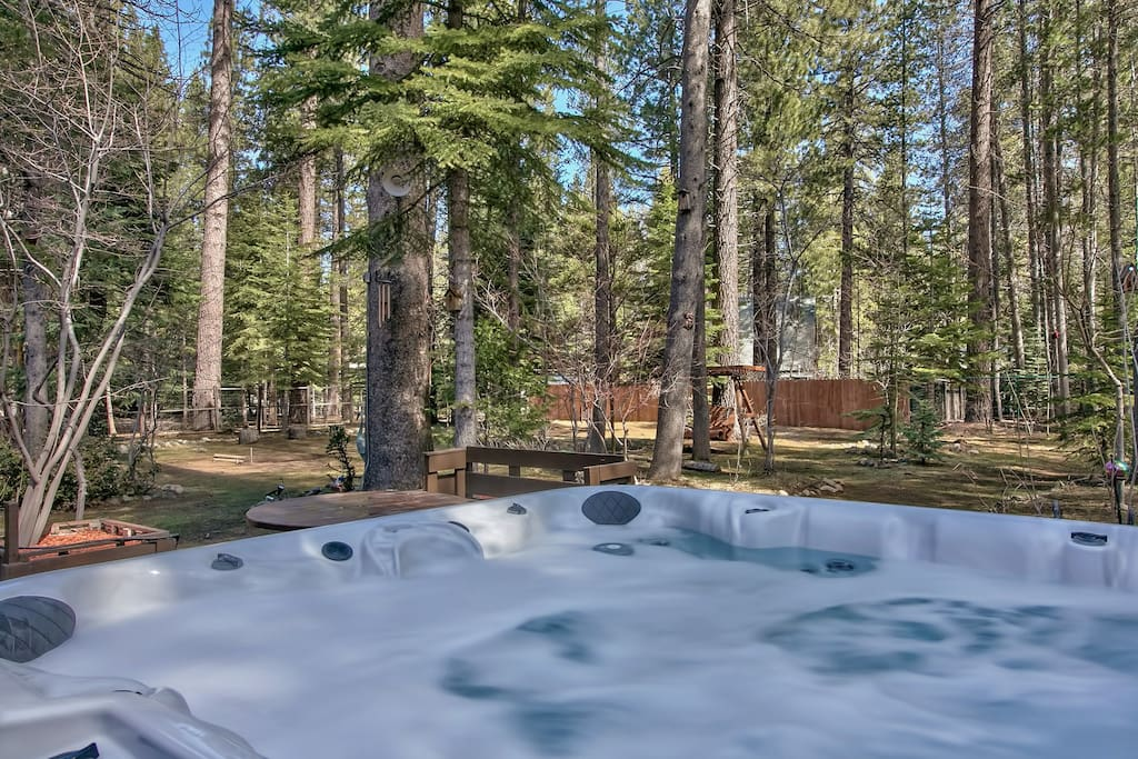 Relax your muscles after a day of nearby adventures in the back deck hot tub with room for 6