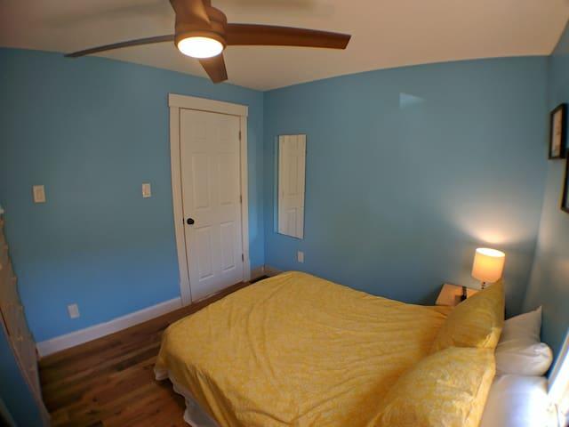 Bedroom #1 with a fan.