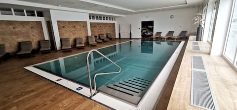 Apartment with pool, sauna and free parking
