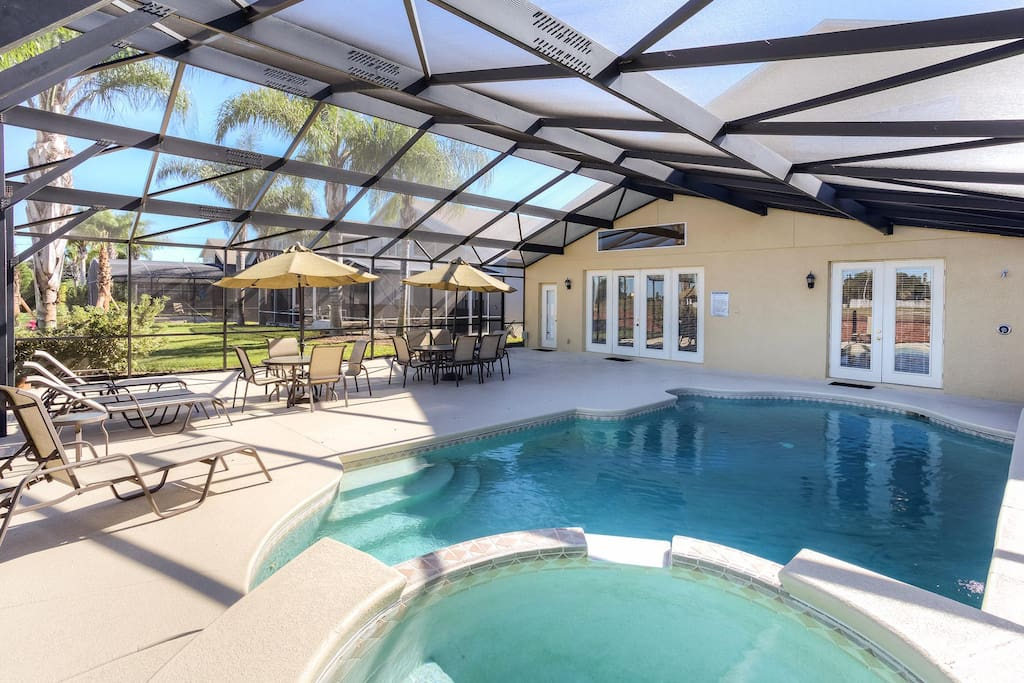 North-facing private pool with spillover spa, spacious patio with umbrella table seating for 10, outdoor shower and barbecue grill