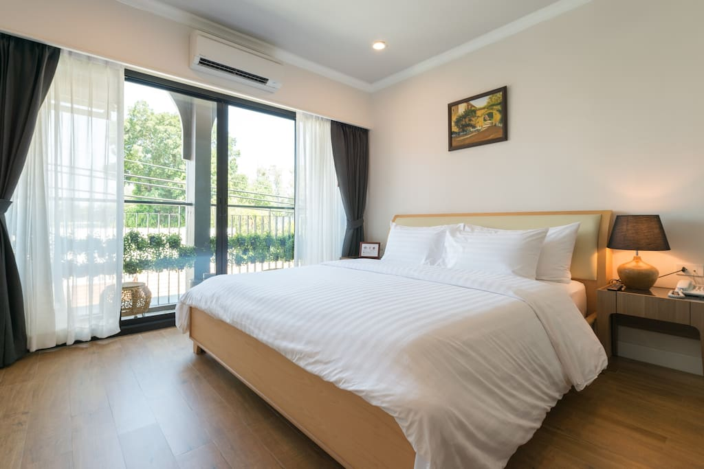 Room 301 - Comfortable king size bed with balcony.
