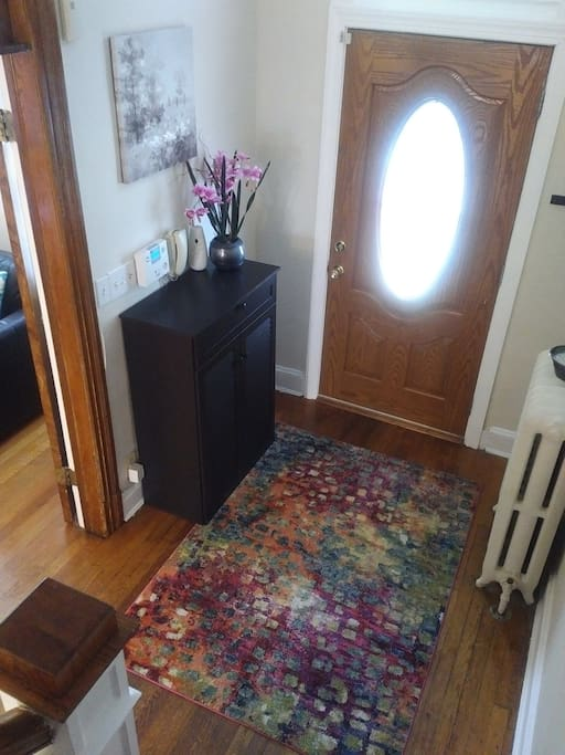 Foyer at entrance door has shoe cabinet to store shoes and other accessories.