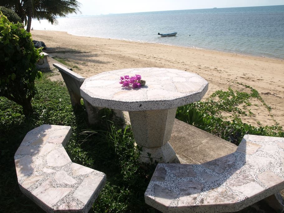Another photo of our elevated, common area beachside table, where you have a 180 view of the beach and the sea.