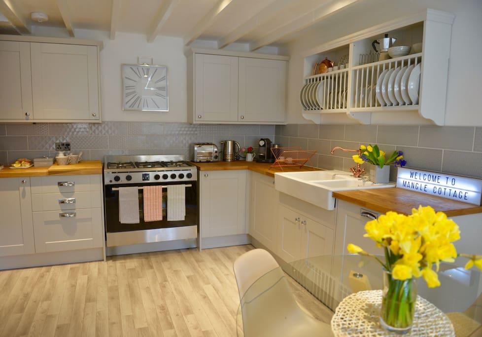 Kitchen with dishwasher,range, washing machine and Nespresso machine.