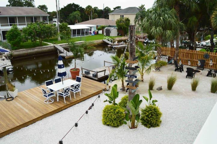 Resort style beach backyard featuring saltwater canal
