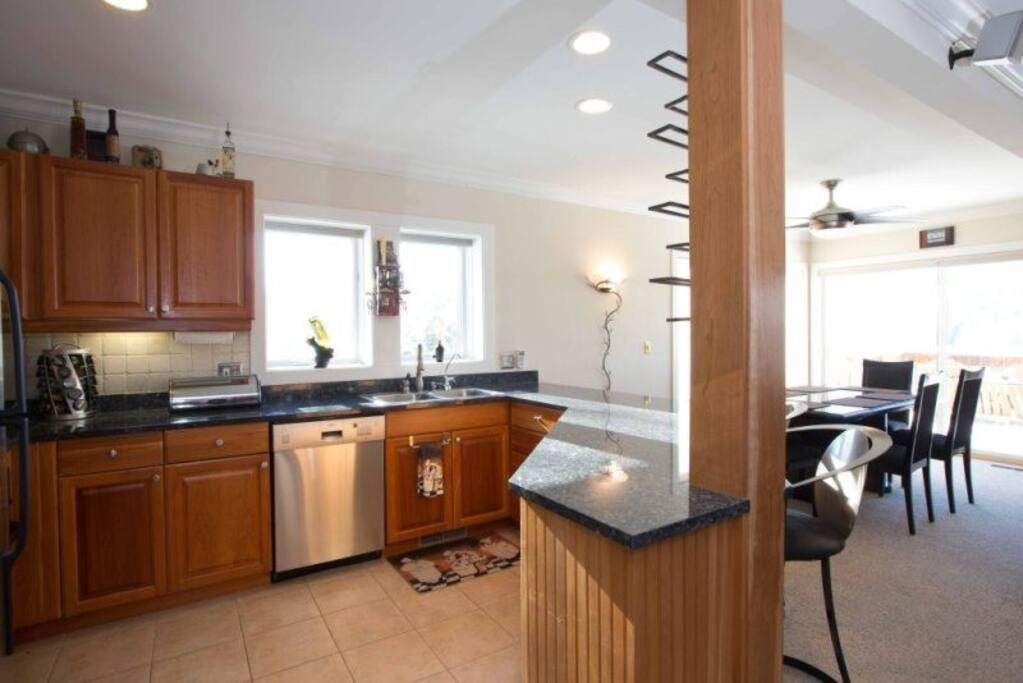 Very well-appointed kitchen with granite counters, stainless appliances and upscale cookware.